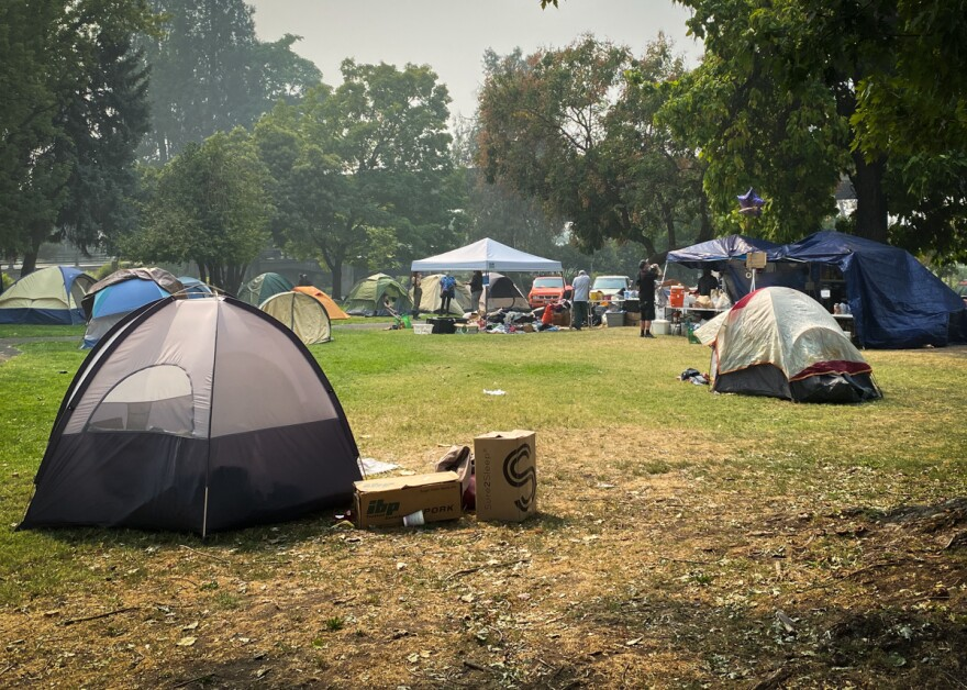 A collection of about 70 tents have appeared at Hawthorne Park in Medford following wildfires that displaced thousands of people.