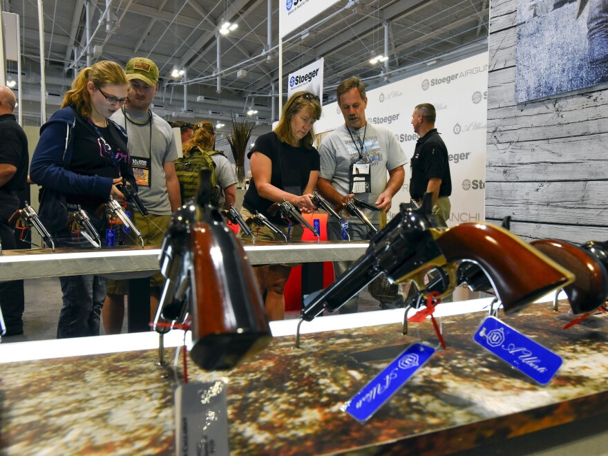 Attendees visit the trade booths during the National Rifle Association's annual meeting in Nashville, Tenn., in April.