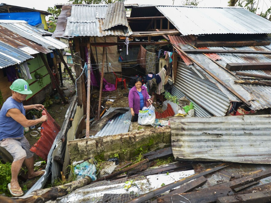 A house is roofless after strong winds from Typhoon Hagupit hit Tacloban City on the island of Leyte on Sunday.