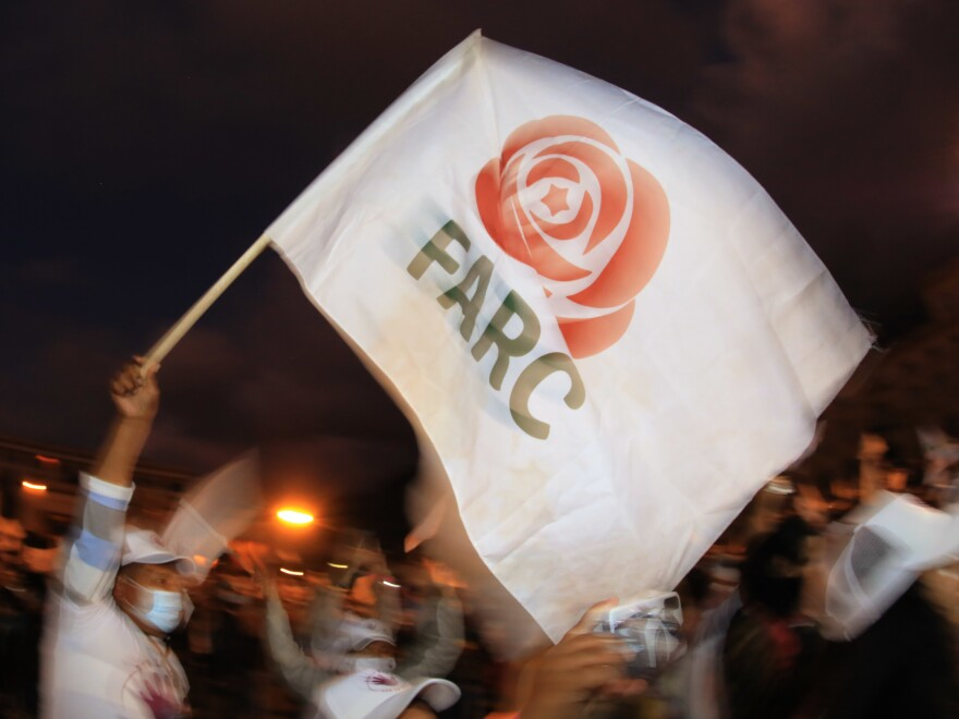 A former FARC guerrilla member waves a FARC political party flag during a demonstration in Bogota on Nov. 2. A federal court overturned an asylum decision Wednesday, holding that FARC death threats counted as persecution.×