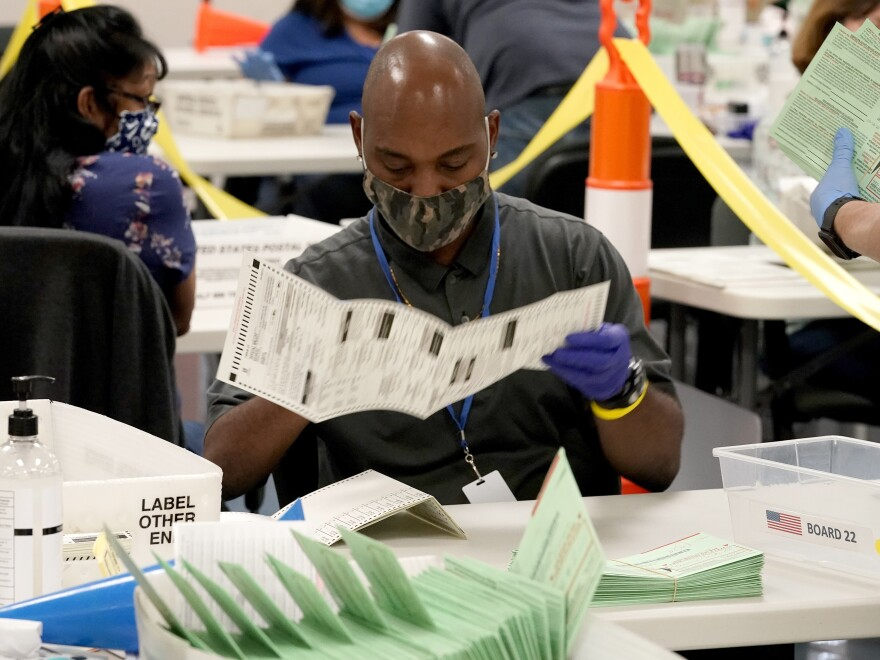 Election workers sort ballots at the Maricopa County Recorder's Office in Phoenix.