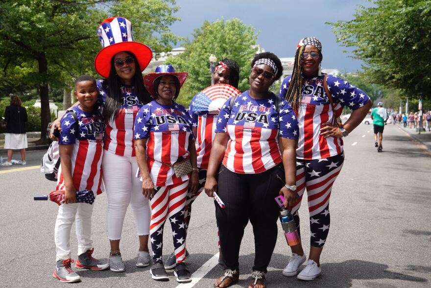 Stephen Asimobi (from left), Helen Asimobi, Theresa Omeyeka, Michelle Nwuokoye, Mariama Turay and Rachel Biah celebrate the Fourth of July with their festive outfits in Washington, D.C.