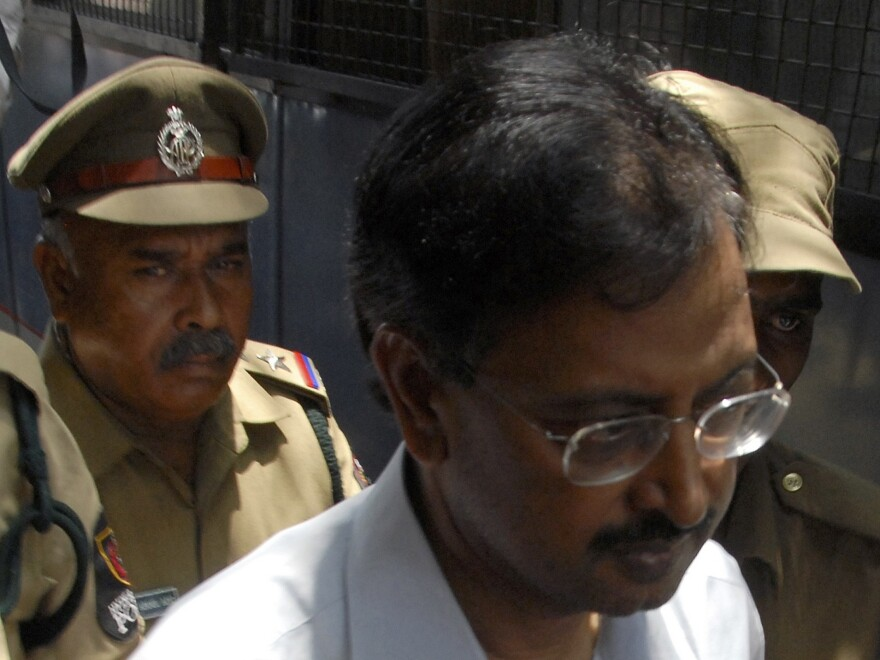 Ramalinga Raju, founder and former chairman of fraud-hit Satyam Computer Services, is escorted from a court in the southern Indian city of Hyderabad in April 2009. Raju and nine other defendants have been convicted of fraud and conspiracy.