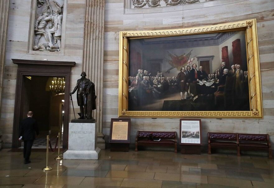 A painting by John Trumbull titled <em>Declaration of Independence</em> hangs on the wall inside the U.S. Capitol on May 17, 2017.