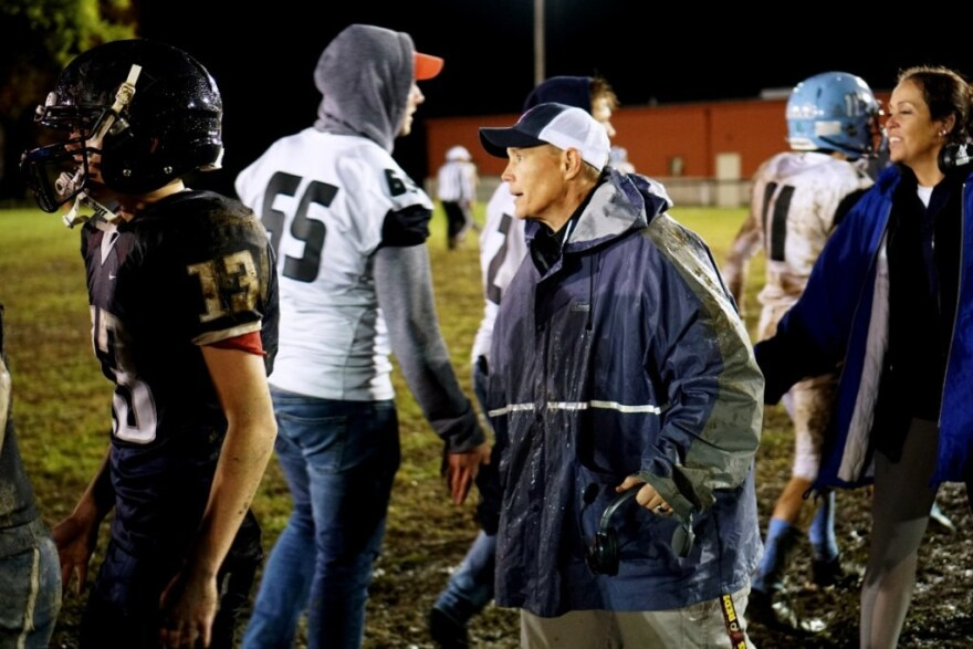 Thomas slaps hands with Parkersburg Catholic players and coaches following Hannan's 0–43 loss on Oct. 27, 2018.