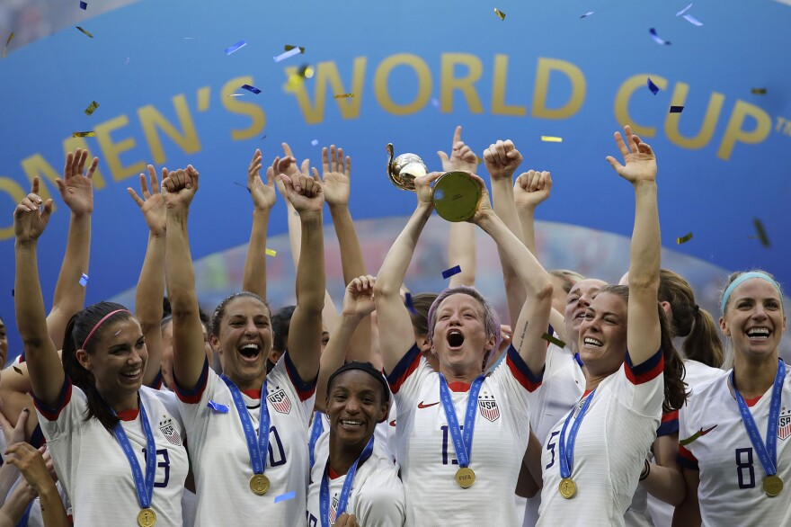 United States' Megan Rapinoe lifts up a trophy after winning the Women's World Cup final soccer match between U.S. and The Netherlands at the Stade de Lyon in Decines, outside Lyon, France, Sunday, July 7, 2019. (Alessandra Tarantino/AP)