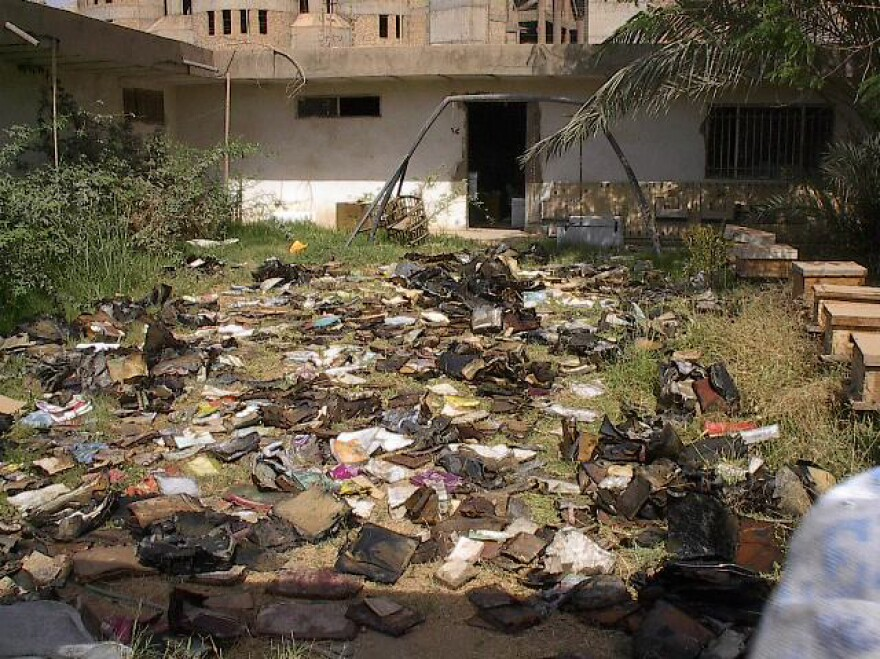 Documents from the Iraqi Jewish community dry outside the Mukhabarat, Saddam Hussein's intelligence headquarters, in Baghdad.