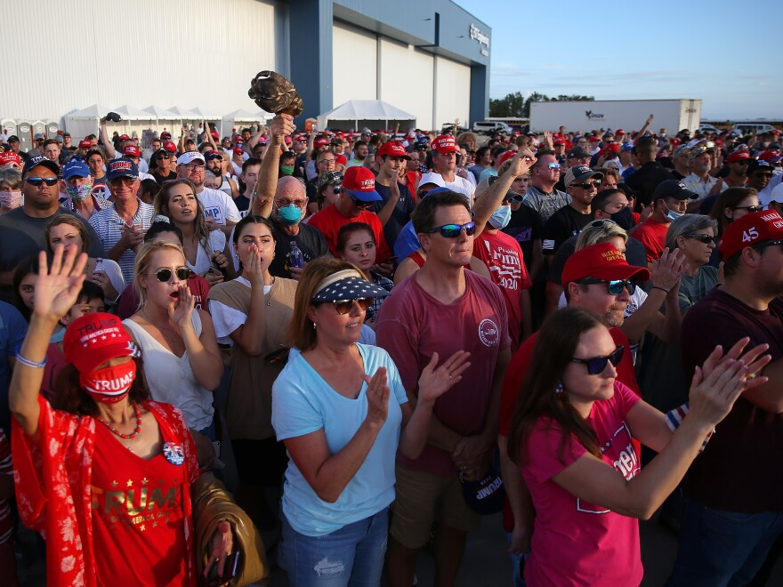 Supporters cheer during a Trump rally in Pensacola, Fla. Rallies and in-person events have been a key part of the campaign strategy, even in the midst of the pandemic.