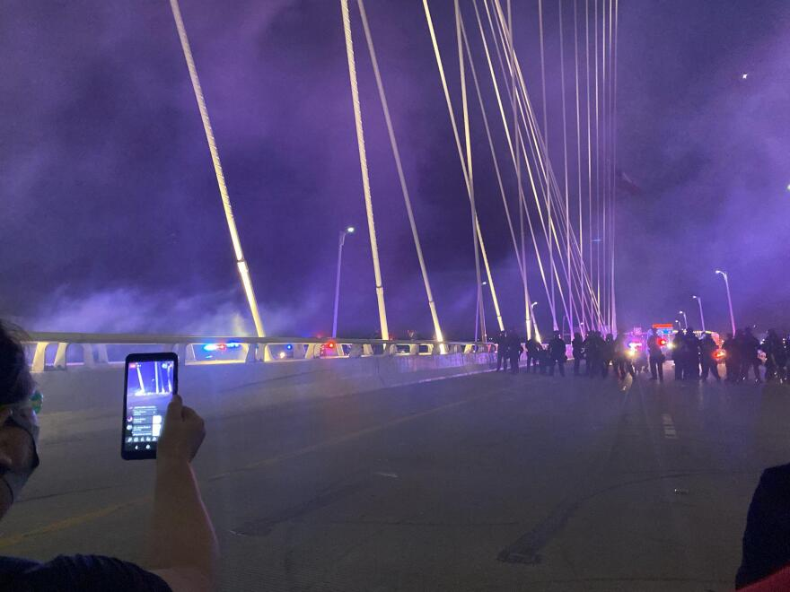 Police confronted kneeling protesters on the Margaret Hunt Hill Bridge in Dallas on June 1, 2020.