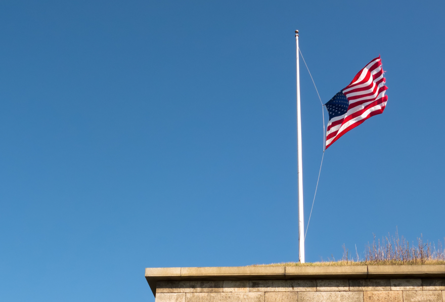 An American flag at half-staff.