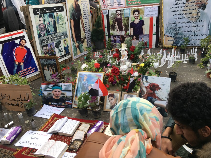 In a shrine in Baghdad's Tahrir Square, mourners gather at a memorial to one of the protesters killed by security forces.