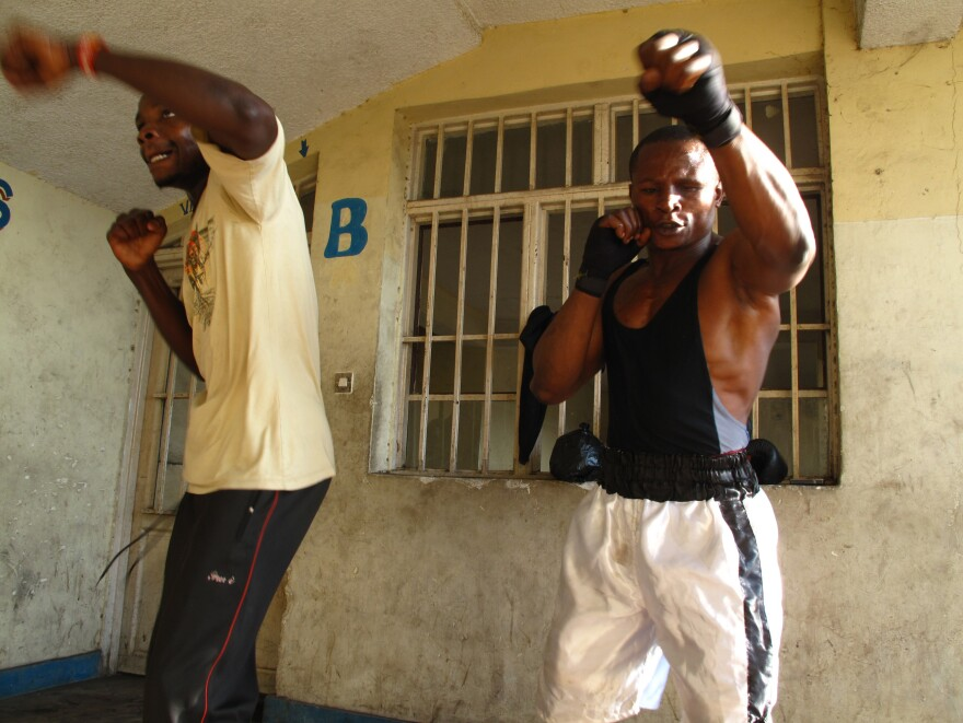 Kibomango trains with former child soldier Fabrice Djef.