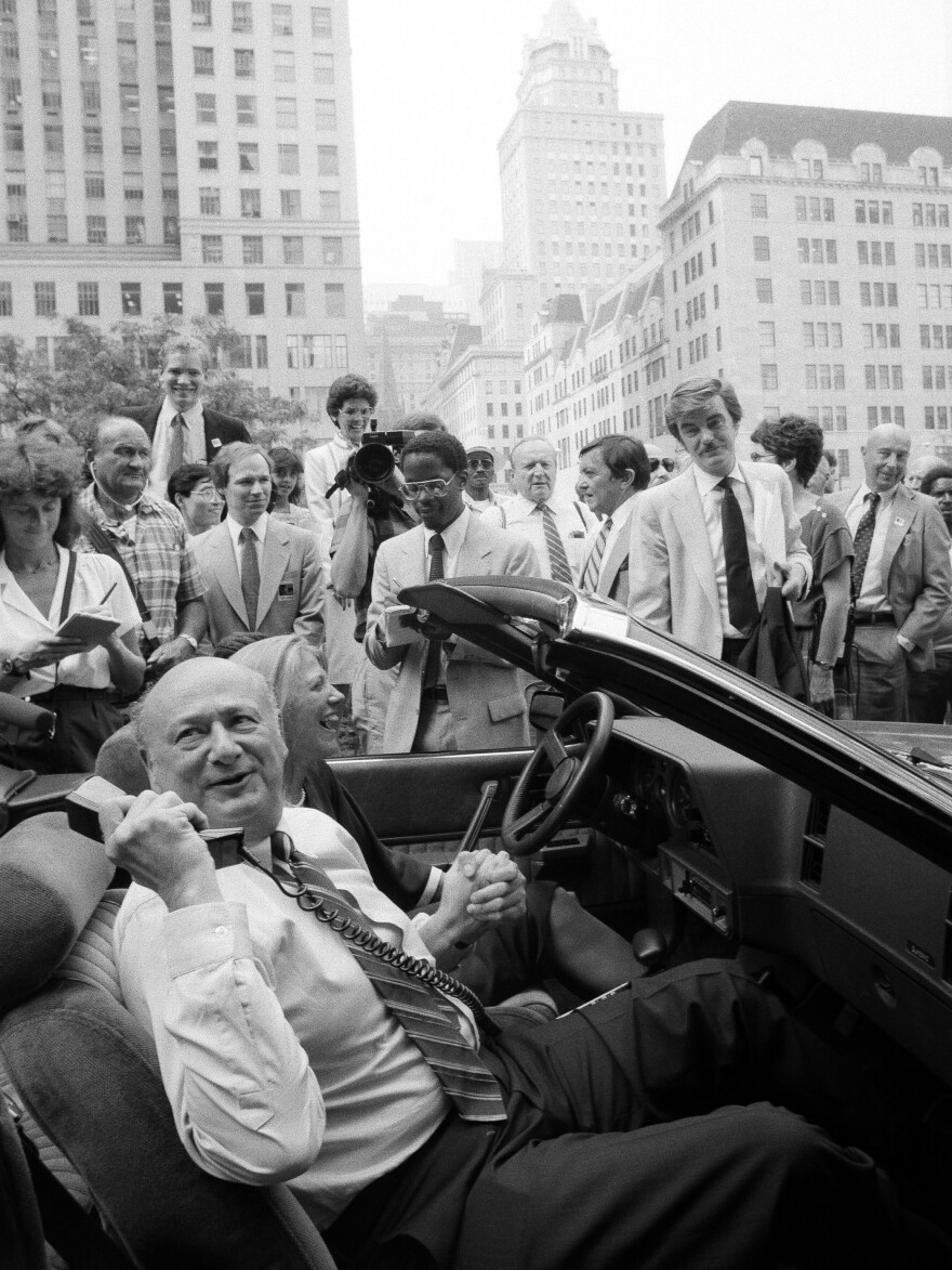 Then-New York City Mayor Ed Koch makes a phone call using a cellular telephone in a car in 1984.