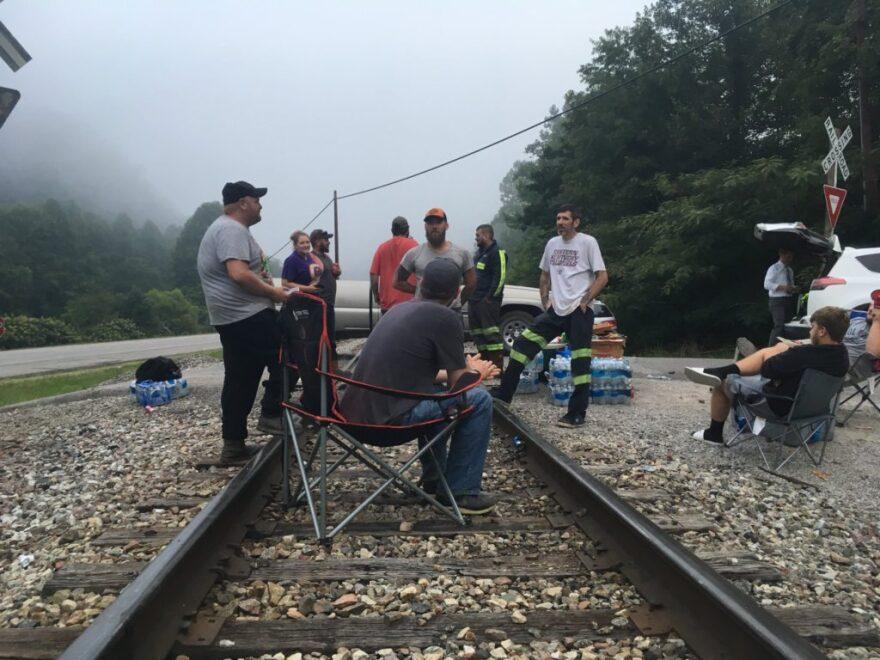 Protesting miners block train tracks in morning fog.