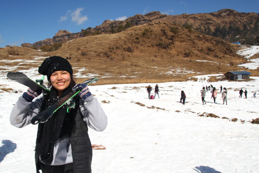 Doma Hyolmo, 15, carries skis during her first attempt at skiing in Kalinchowk, a village in the mountains of Nepal. While a few adventure tourists come to ski in Nepal, most Nepalese haven't tried the sport.