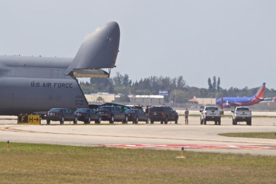 The U.S. Secret Service unloads motorcade vehicles from a United States Air Force cargo plane at Palm Beach International Airport on April 5, 2017.
