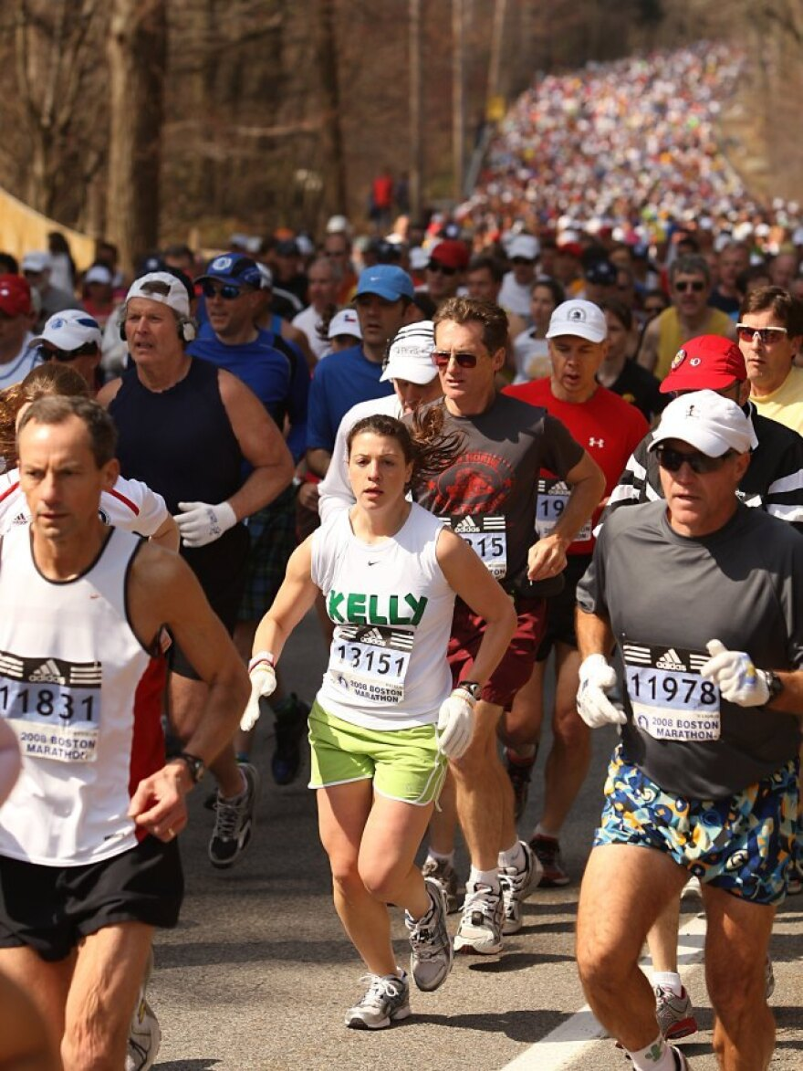 Runners compete in the 2008 Boston Marathon. Faced with a rising number of qualified entries, the race's organizers plan to adjust the rules to favor runners with the fastest times.