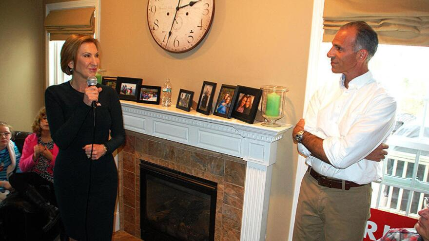 "Carly Fiorina speaks at a house party event at the home of Rich Ashooh (right) in Bedford, N.H. in November. ""Less is more with some of these house parties."" Ashooh said."