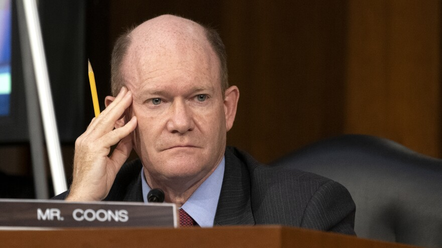Sen. Christopher Coons, D-Del., looks on as Supreme Court nominee Judge Amy Coney Barrett testifies before the Senate Judiciary Committee on the third day of her confirmation hearing.