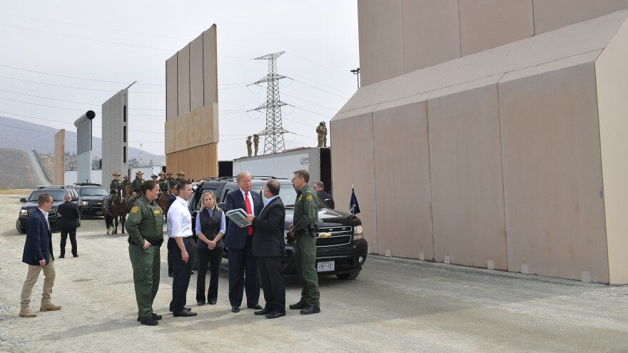 President Trump (center) is shown border wall prototypes in San Diego, Calif., on March 13, 2018.
