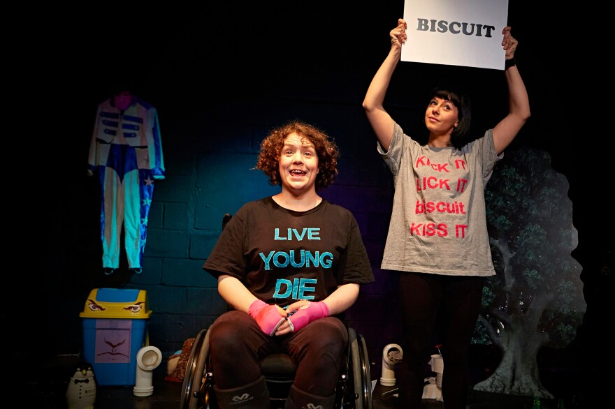 "Jess Thom (left) and Jess Mabel Jones from Thom's show, <em>Backstage in Biscuit Land</em>. Thom's website says she's ""changing the world, one tic at a time."""