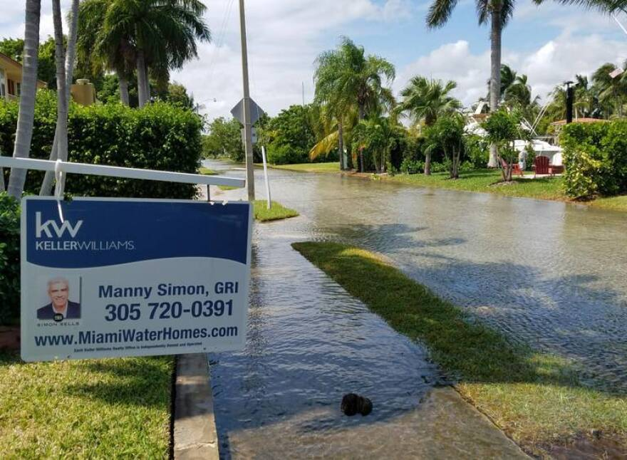 Flooding from an October king tide in Miami Shores fills streets, sidewalks and driveways at its peak. Florida doesn't have flood disclosure laws, so home sellers don't have to tell buyers about previous flooding. TROPIC MOTION