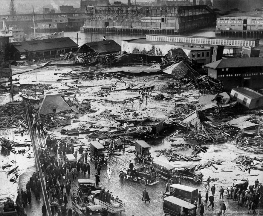 The ruins of tanks containing 2.5 million gallons of molasses lie in a heap after an eruption that hurled trucks against buildings and crumpled houses in the North End of Boston on Jan. 15, 1919.