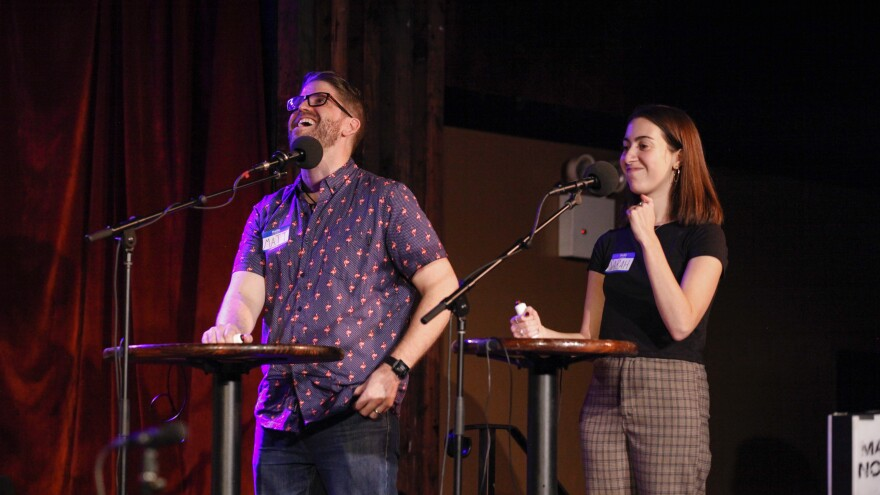 Contestants Matt Lyman and Sarah Gruber play a game on on <em>Ask Me Another</em> at the Bell House in Brooklyn, New York.