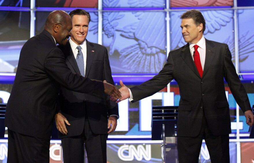 "<p>""Brother"" Herman Cain shakes hands with Texas Gov. Rick Perry, Tuesday, Oct. 18, 2011.</p>"