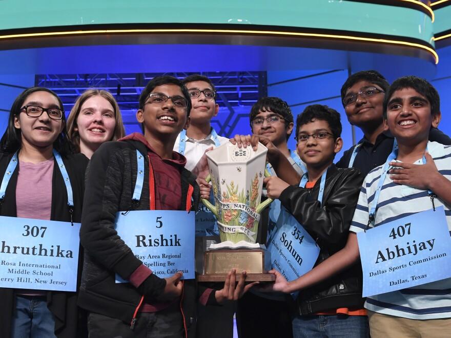Co-champions of the 2019 Scripps National Spelling Bee (from left) Shruthika Padhy, Erin Howard, Rishik Gandhasri, Christopher Serrao, Saketh Sundar, Sohum Sukhatankar, Rohan Raja and Abhijay Kodali hold the trophy in Oxon Hill, Md., on Friday.