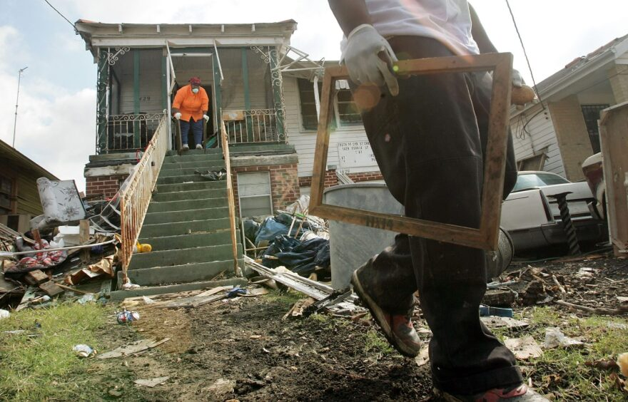 Zadie Smith (L) and her son, Jonathan, clean their home in the heavily damaged Ninth Ward November 21, 2005 in New Orleans, Louisiana.