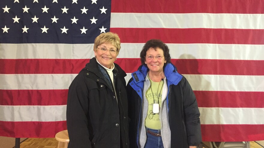 "Linda Bimbo (left) and friend Muriel Charron attended John Kasich's Monday evening town hall in Kingston, N.H. ""I really came in kind of undecided,"" Bimbo said. ""But, I love this guy. I love his experience."""