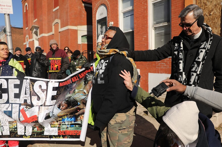 "Activists participate in a ""Peace and Healing Walk"" during Baltimore's third ""Ceasefire Weekend"" on February 3, 2018."