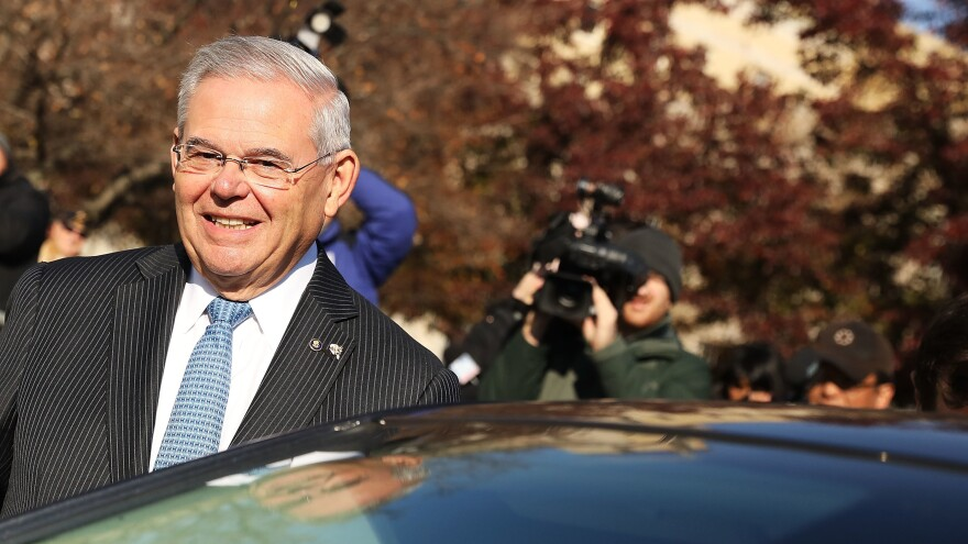 Sen. Robert Menendez, D-N.J., smiles as he leaves federal court in November.