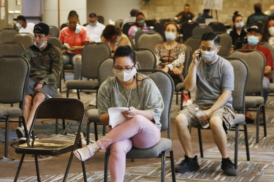 People wait to speak with representatives from the Oklahoma Employment Security Commission about unemployment claims Thursday, July 9, in Midwest City, Oklahoma.