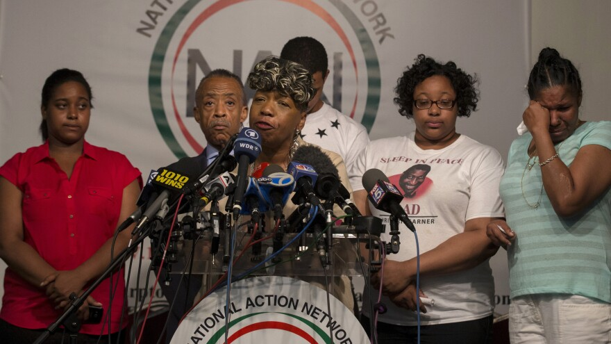 Gwen Carr, the mother of Eric Garner, speaks at a news conference at the National Action Network in New York a day after settling a $5.9 million wrongful death case with the city. At far right is Garner's widow, Esaw Garner.