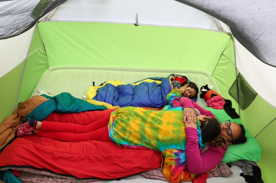 Melissa, Lola and Lola's younger sister, Izel, enjoy down time together as heavy rains restrict the family's plans while camping in Youngstown, N.Y.