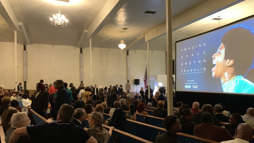 <em></em>Viewers find their seats inside The New Temple Missionary Baptist Church for the LA screening of <em>Amazing Grace. </em>