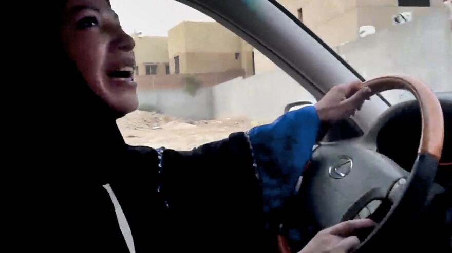 A file image taken from a video released by Change.org shows a woman driving a car as part of a 2011 campaign to defy Saudi Arabia's ban on women driving.
