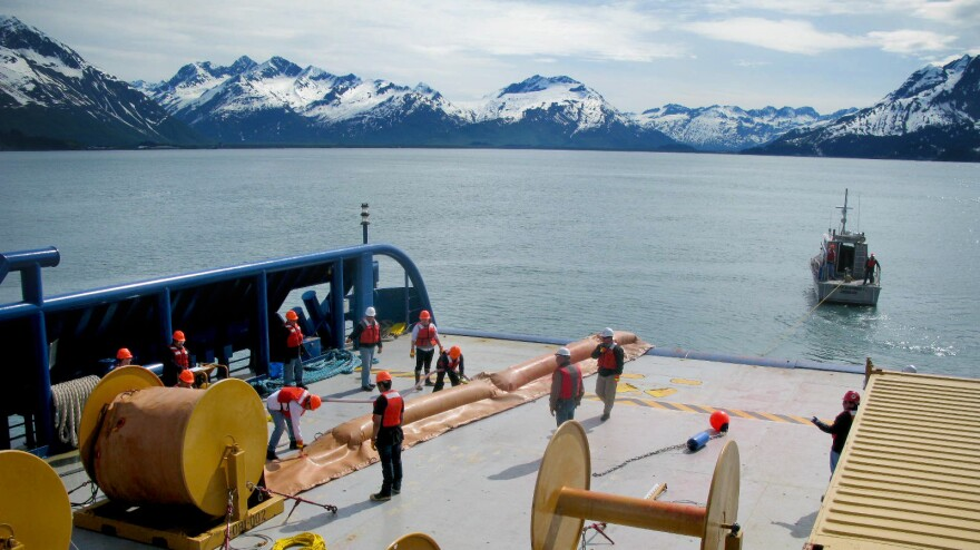 Trainees with Royal Dutch Shell learn to deploy oil spill booms in the waters near the port of Valdez in Alaska. The company is training about 200 spill responders.