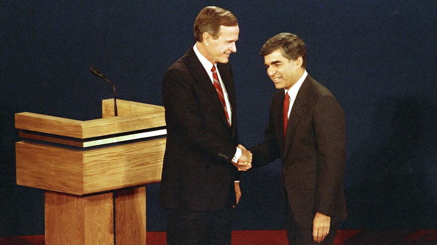 Then-Vice President George H.W. Bush (left) shakes hands with candidate Michael Dukakis at the start of the presidential debate in Winston-Salem, N.C., in 1988.