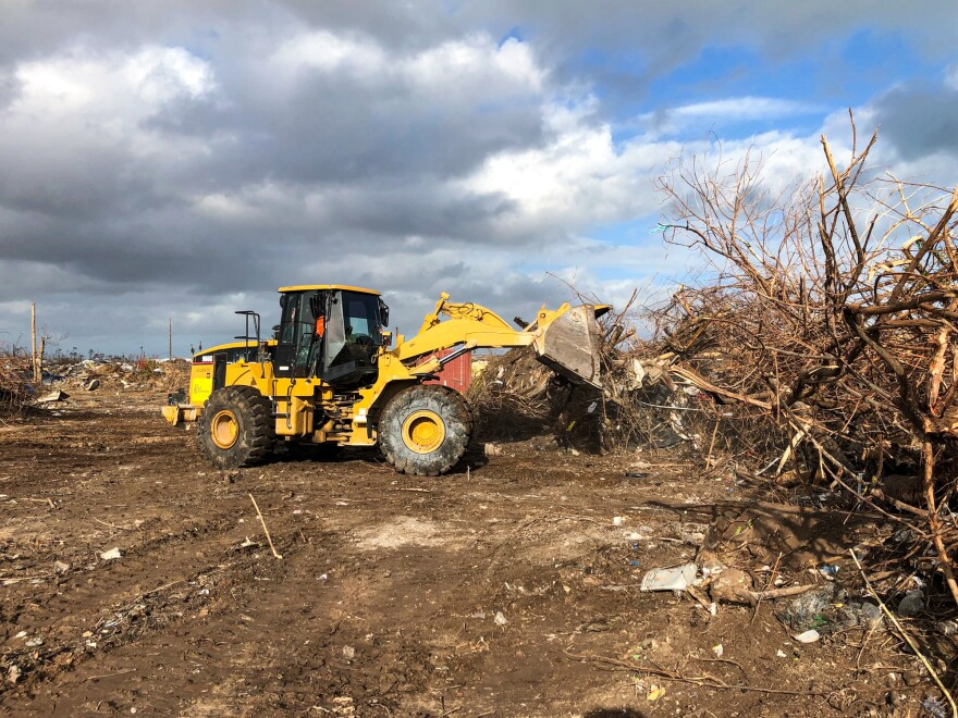 Debris is cleared from what used to be a shantytown known as The Mudd. Home to thousands of Haitian migrants, it was flattened by the hurricane.