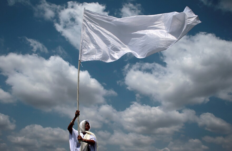 A member of the faithful takes part in the procession of the Via Crucis in Managua, Nicaragua, on Friday.