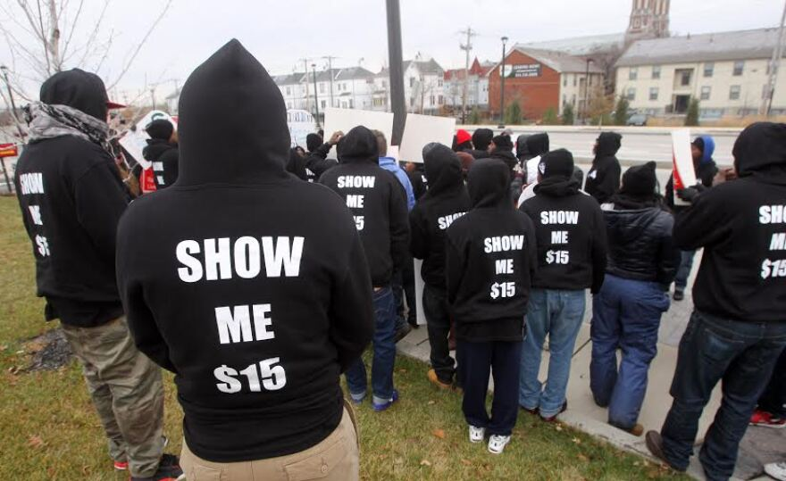 Fast food workers prepare to march around a McDonalds restaurant, taking part in a massive one day fast food industry strike demanding higher wages in St. Louis on December 5, 2013.