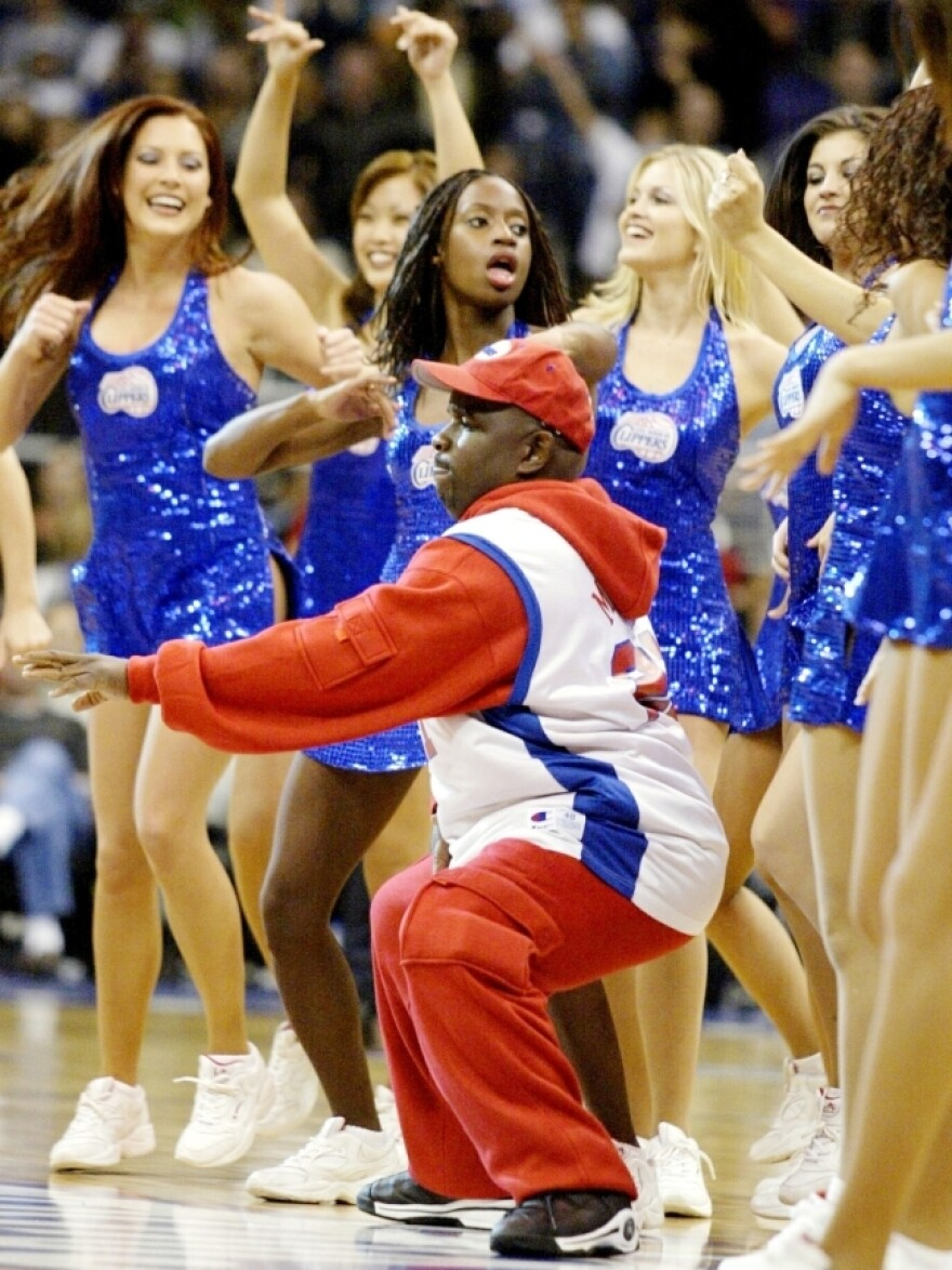 """Clipper Darrell"" dances with the ""Clipper Spirit"" during a game against the Memphis Grizzlies at the Staples Center in Los Angeles in 2002."