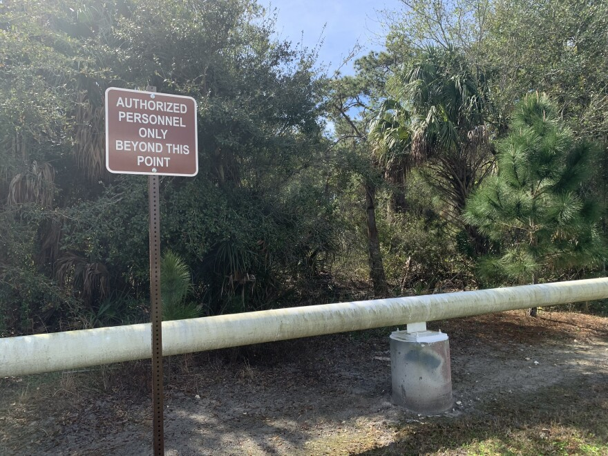 A restricted sign tells passersby not to enter the wooded area of MacDill Air Force Base where a cemetery could be located.