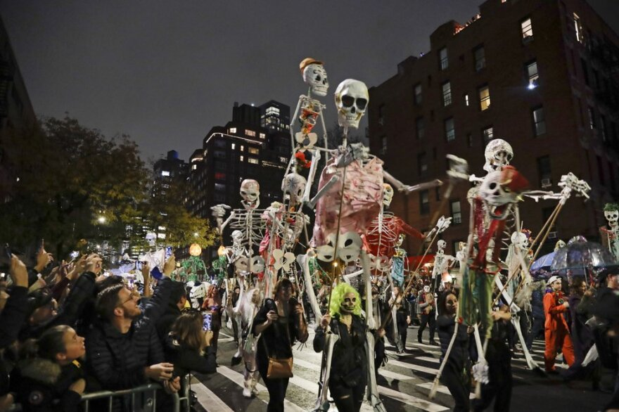 Revelers march during the Greenwich Village Halloween Parade in New York on Oct. 31, 2019.