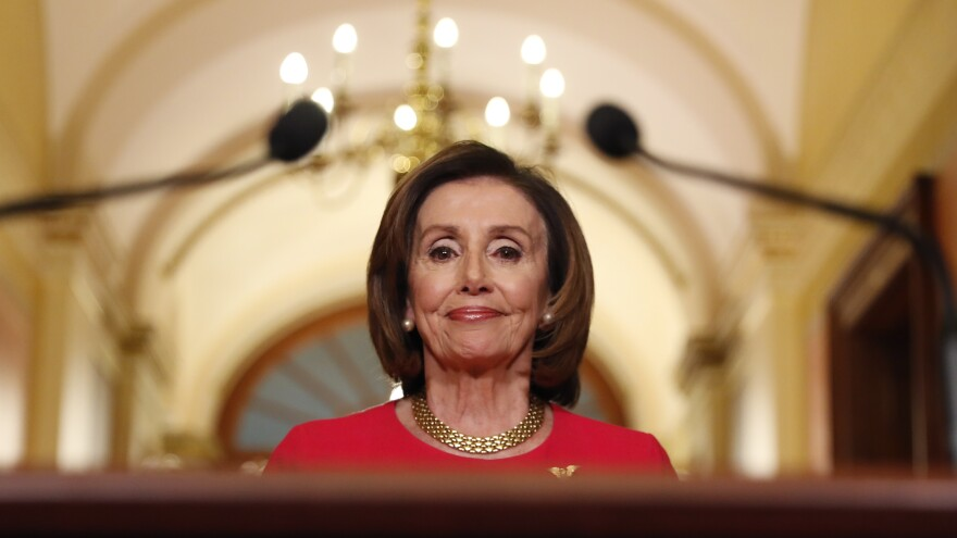 House Speaker Nancy Pelosi arrives Monday to speak outside her office on Capitol Hill. The day was filled with back-and-forth in the Senate over the House Democrats' financial stimulus package.
