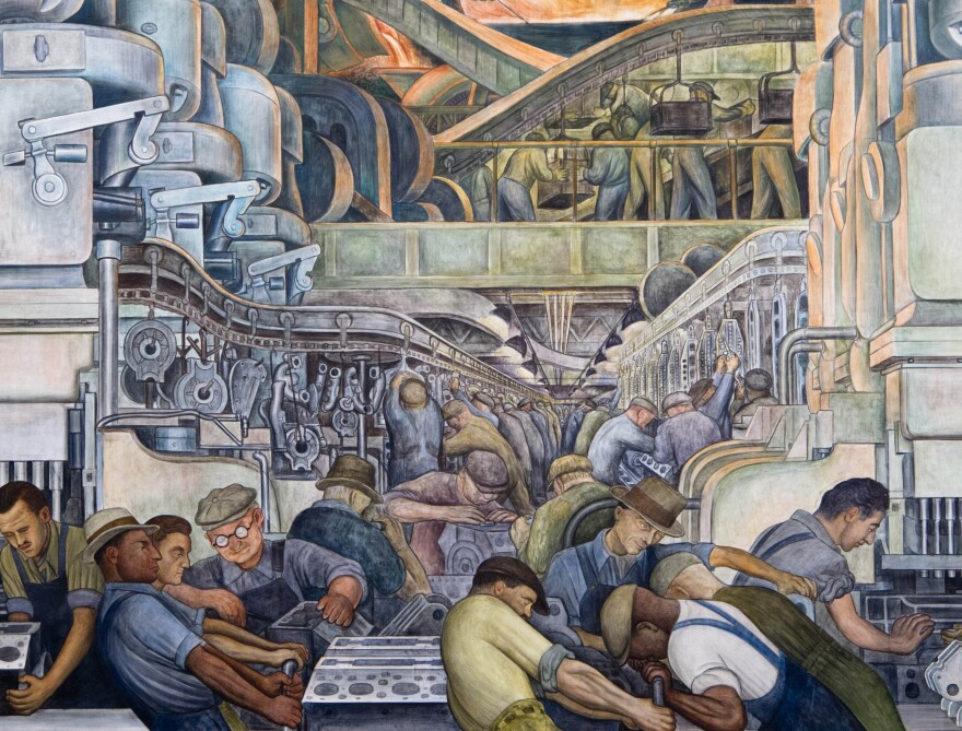 """A detail from the north wall of Diego Rivera's <em>Detroit Industry</em> murals shows workers on the automobile assembly line. After Detroit declared bankruptcy, the murals were at risk of being sold. <a href=""""http://media.npr.org/assets/img/2015/03/16/image-258detroit-industry---north-wall-detail_custom.jpg"""">Click here for a larger view.</a>"""