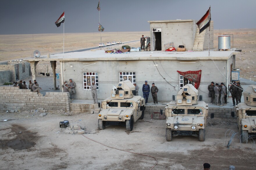Police meet in the village of Mahana, which was retaken from the Islamic State a few months ago. The police have been training and hope to return to their home city of Mosul soon.